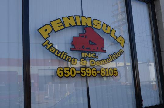 Peninsula Hauling & Demolition - Front Window