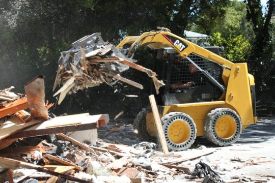Performing demolition services